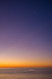 Sunset over Mornington Peninsula with new moon high up Stock Image