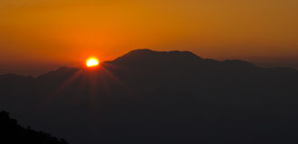 Sunset over the mountain. Landscape Royalty Free Stock Images