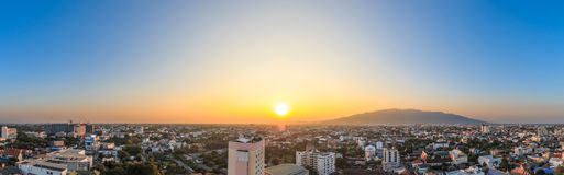 Sunset over mountain and city, cityscapes panorama.  stock photo