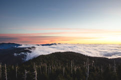Sunset over mountain clouds Royalty Free Stock Photos