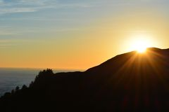 Sunset Over the Mountain. Evening sunset over the ocean and mountain Stock Photos