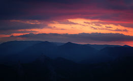 Sunset over the mountain hills Royalty Free Stock Photo