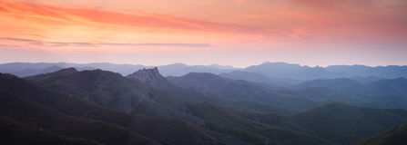 Sunset over the mountain hills Stock Photo