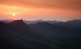 Sunset over the mountain hills Stock Photography