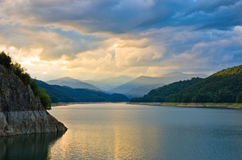 Sunset over mountain lake Stock Photo