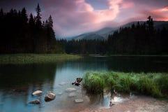 Sunset over mountain lake stock image