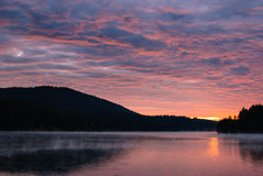 Sunset over a mountain lake. Stock Photo