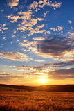 Sunset over mountain meadow Royalty Free Stock Photos