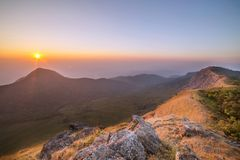 Sunset over mountain Stock Images