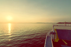 Sunset over mountain from passenger ship in the sea Stock Photos