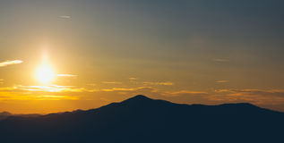 Sunset over mountain peaks royalty free stock images