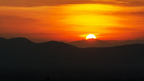 Sunset over mountain range. Beauty of the sun during the time sunset over the mountain range Royalty Free Stock Image