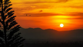 Sunset over mountain range Stock Photography