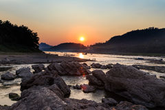 Sunset over mountain and river Royalty Free Stock Photo