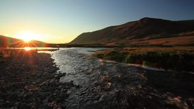 Sunset over mountain river in summer. Sunset over mountain river in the summer stock video footage