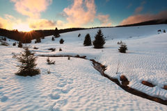 Sunset over mountain river in winter Stock Images