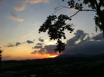 Sunset with thundercloud over the mountain Stock Photos