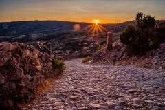 Sunset over mountain trail. Sunset over a stone path in Moustiers Sainte Marie Stock Photos