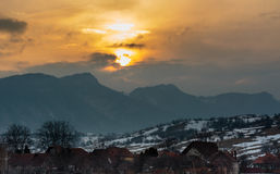 Sunset over mountain village Royalty Free Stock Images