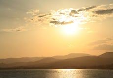 Sunset Over the Mountainous Shoreline Stock Image
