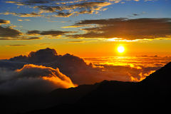 Sunset over mountains. Scenic view of colorful sunset and cloudscape viewed from summit of Haleakala volcano, Maui, Hawaiian Islands Stock Photo