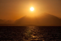 Sunset over a Mountains Stock Photo