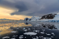 Sunset over the mountains and drifting icebergs at Lemaire Strai Royalty Free Stock Image