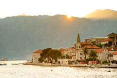 Sunset over Mountains and Famous Ancient Perast Town on Kotor Bay, Montenegro, Europe. Royalty Free Stock Photography