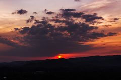 Sunset over mountains or hills Stock Photography