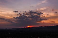 Sunset over mountains or hills Stock Image