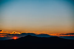 Sunset over mountains royalty free stock photos