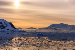 Sunset over the mountains and icebergs at Lemaire Strait Royalty Free Stock Photo