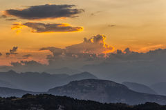 Sunset over the Mountains. Italy. The sun setting over the mountains in Italy Stock Photos