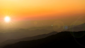Sunset over the mountains layers background Stock Images