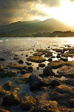 Sunset over the mountains and low tide on the island of Tioman.  Stock Image