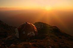 Sunset over mountains with a refuge. Sunset over mountains. Varful Ascutit refuge, Piatra Craiului mountains, Romania Stock Photos