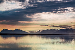 Sunset over the mountains by the sea Royalty Free Stock Images