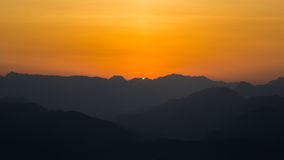 Sunset over Mountains. Taken from a mountain top in Zhejiang Province, China Royalty Free Stock Photo