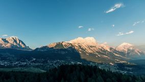 Sunset over Mountains timelapse. Dolomites Alps, Italy Cortina D`Ampezzo stock video footage