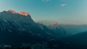 Sunset over mountains timelapse Dolomites Italy Alps stock video footage