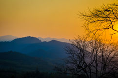The sunset over the mountains Stock Photos
