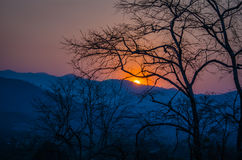 The sunset over the mountains Royalty Free Stock Image