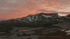 Sunset over the mountains. Trolltunga area, Norway. Smooth dolly shot stock video