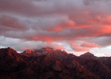 Sunset over the  mountains in Tucson, Arizona. Exotic red mountain sunset in Tucson, Arizona Royalty Free Stock Image