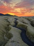 The sunset over the mud volcanoes. The sunset over the mud river in Berca mud volcanoes in Romania Stock Photo