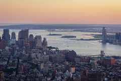 Sunset over New York, Ellis Island and Liberty Island - Aerial v. Aerial view of Lower Manhattan (with New York Harbor, West Village, Battery Park and Financial Stock Photos