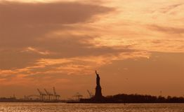 Statue of Liberty at Sunset Royalty Free Stock Photography