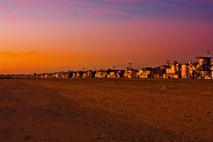 Sunset over Newport beach. Scenic view view of colorful orange sunset over Newport beach with row of homes in background; California, U.S.A royalty free stock images