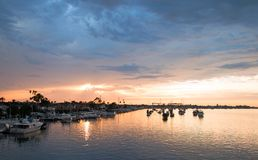 Sunset over Newport Beach Harbor in southern California USA. Sunset over Newport Beach Harbor in southern California United States royalty free stock photos