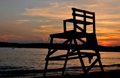 Sunset Over Niles Beach. Brilliant sunset shot from Niles Beach in Gloucester, MA with lifeguard stand in the foreground stock image